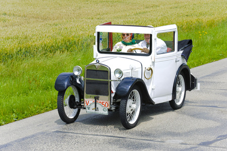 rally car: LANDSBERG, GERMANY - JULY 12, 2014: Public oldtimer rally organized by Bavarian city Landsberg for at least 80 years old veteran cars with unknown drivers in BMW Dixi, built at year 1929