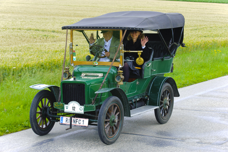 LANDSBERG, GERMANY - JULY 12, 2014: Public oldtimer rally organized by Bavarian city Landsberg for at least 80 years old veteran cars with unknown drivers in Rover 8 HP, built at year 1906 Editorial