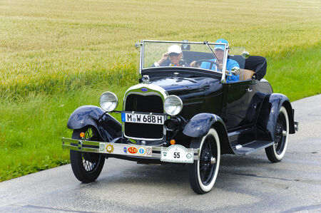 LANDSBERG, GERMANY - JULY 12, 2014: Public oldtimer rally organized by Bavarian city Landsberg for at least 80 years old veteran cars with unknown drivers in Ford A, built at year 1928