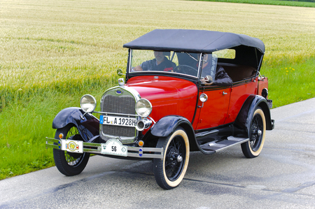 LANDSBERG, GERMANY - JULY 12, 2014: Public oldtimer rally organized by Bavarian city Landsberg for at least 80 years old veteran cars with unknown drivers in Ford A Phaeton de Luxe, built at year 1928