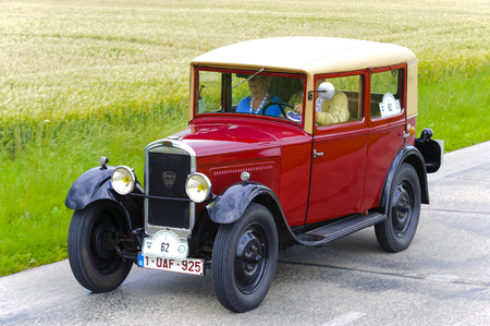 oldtimer: LANDSBERG, GERMANY - JULY 12, 2014: Public oldtimer rally organized by Bavarian city Landsberg for at least 80 years old veteran cars with unknown drivers in Peugeot 201, built at year 1929