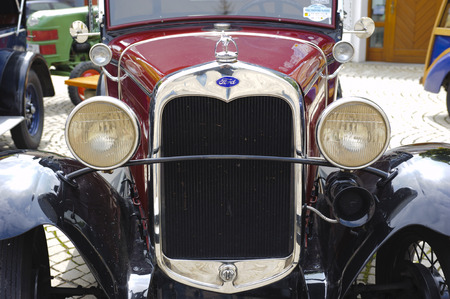 LANDSBERG, GERMANY - JULY 12, 2014: Public oldtimer rally in Bavarian city Landsberg for at least 80 years old veteran cars with a front view of Ford A, built at year 1930