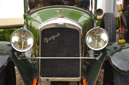 bl: LANDSBERG, GERMANY - JULY 12, 2014: Public oldtimer rally in Bavarian city Landsberg for at least 80 years old veteran cars with a front view of Peugeot BL 177, built at year 1923