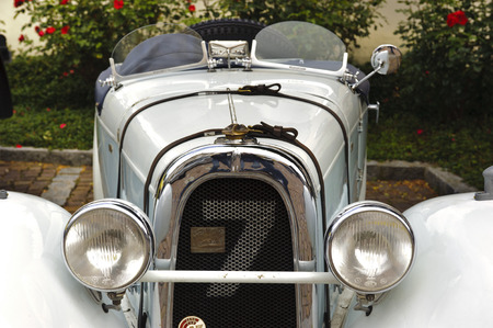 10 to 12 years old: LANDSBERG, GERMANY - JULY 12, 2014: Public oldtimer rally in Bavarian city Landsberg for at least 80 years old veteran cars with a front view of Aero 10, built at year 1929