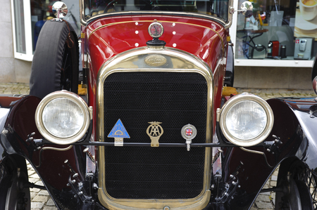 oldtimer: LANDSBERG, GERMANY - JULY 12, 2014: Public oldtimer rally in Bavarian city Landsberg for at least 80 years old veteran cars with a front view of Sunbeam 25 HP, built at year 1926
