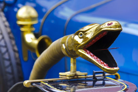 snake head: LANDSBERG, GERMANY - JULY 12, 2014: Public oldtimer rally in Bavarian city Landsberg for at least 80 years old veteran cars with a front view of Delage, built at year 1915 Editorial