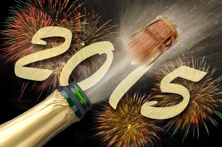 飛び出るシャンパンと花火新年 2015