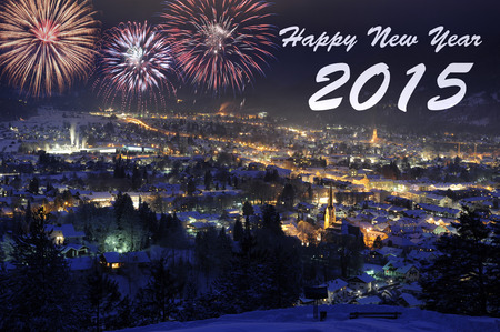 firework at new year over city Garmisch in Bavaria, Germany Stock Photo