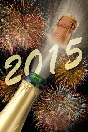2015 の新年の花火とシャンパンを飛び出る