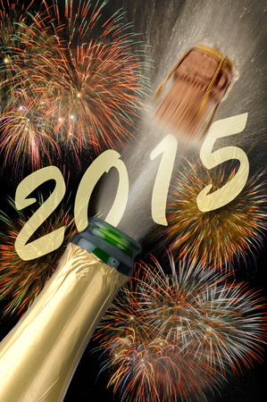 new day: popping champagne with firework for new year 2015