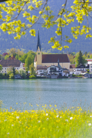 landscape in Bavaria, Germany, with lake Tegernsee and church of city Rottach-Egern photo