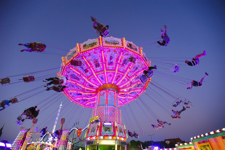 chairoplane: MUNICH, GERMANY - SEPTEMBER 23, 2014: The Oktoberfest in Munich is the biggest beer festival of the world. The visitors have lot of fun with many amusement huts and big carousels.
