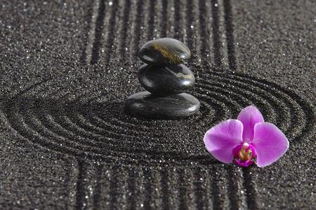 Japanese ZEN garden with stone in sand photo