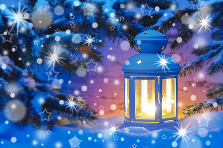 x country: new year and christmas with candle lantern in snow Stock Photo