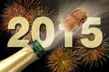 new year 2015 with firework and popping champagne photo
