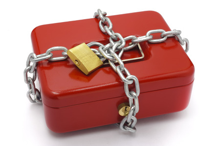 cash box: cash box locked with chain and padlock Stock Photo