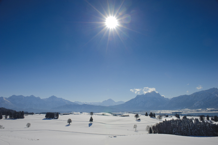 panorama landscape in Bavaria with alps mountains at winter photo