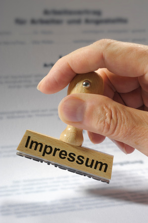 disclaim: Impressum marked on rubber stamp Stock Photo