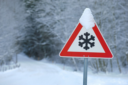 drifting ice: traffic sign warns of snow and ice at road