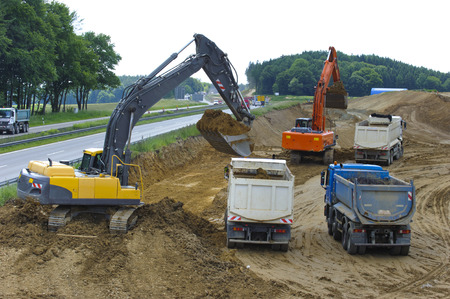 german Autobahn A8 under construction with digger and trucks
