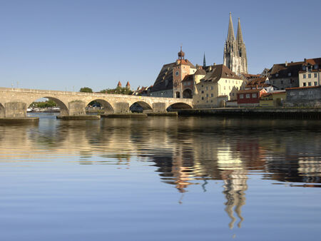 German city Regensburg with historical old stone bridge over river danube photo