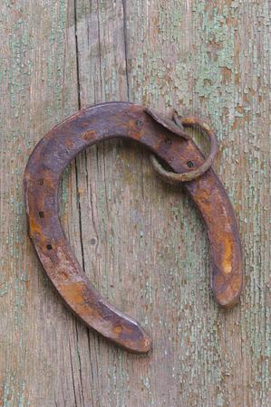old horseshoe on wood photo