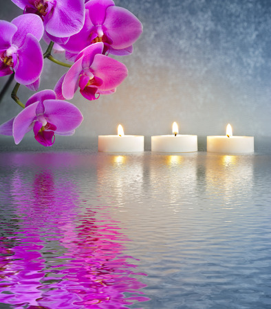 Japanese ZEN garden with candle lights mirroring in water photo