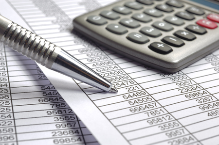 financial budget calculation with summary tables and pen Archivio Fotografico