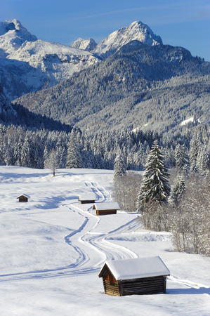 winter landscape with alps mountains nearby castle Elmau in Bavaria photo