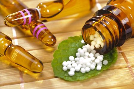 globule: alternative medicine with herbal pills Stock Photo