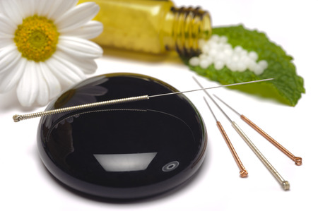 alternative medicine with herbal pills and acupuncture 스톡 콘텐츠