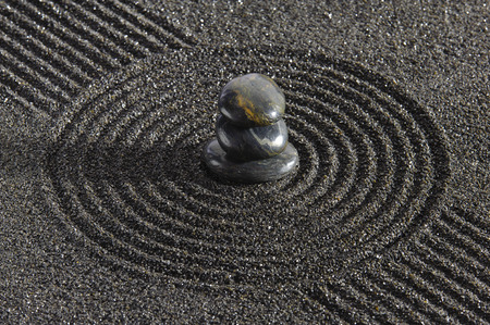 Japanese garden with stacked stones in sand