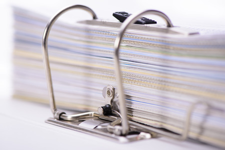ring binder: file folder with stack of documents