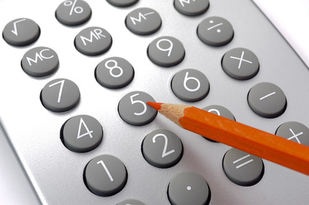 document management: Financial business calculation with calculator and red pencil