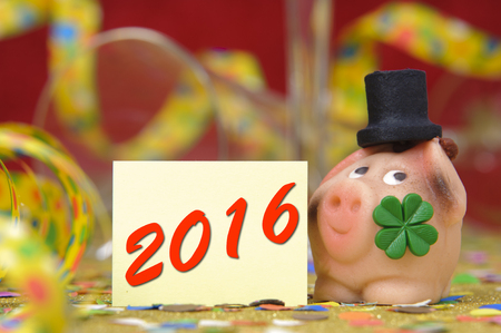 lucky charm: Happy new year 2016 with pig as lucky charm Stock Photo