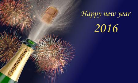 幸せな新年 2016年飛び出るシャンパンと花火を 写真素材