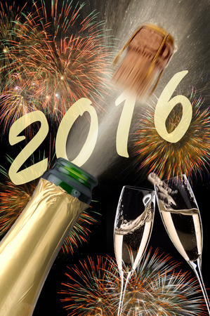 Happy new year 2016 with popping champagne photo
