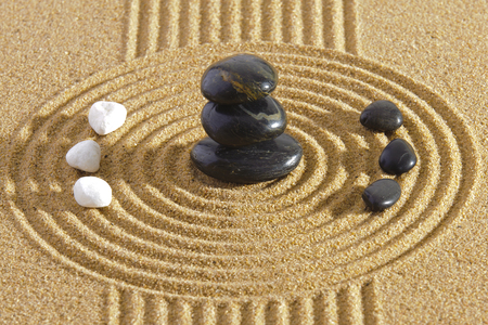 Japanese ZEN garden with Feng shui in sand with stones of yin yang