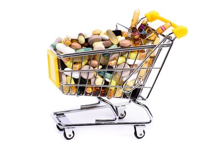 retail therapy: medical pills in cart as symbol for internet shopping Stock Photo