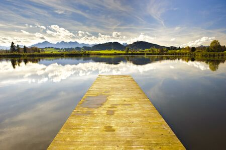 mirroring: panorama landscape in Bavaria at alps mountainss with mirroring in lake