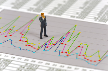 model figure standing on financial chart photo