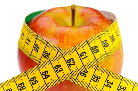 fresh fruits with tape measure and diet against overweight photo