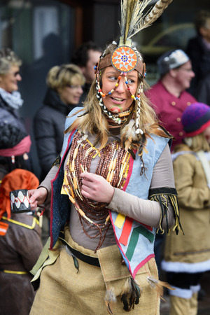 indian headdress: public carnival parade with colorful costumes at city Bad Hindelang in Bavaria, Germany