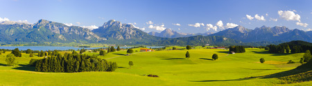 wide panorama landscape in Bavaria, Germany, with alps mountains