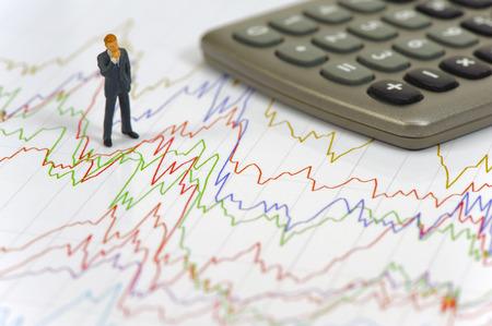 banker: banker standing on chart of stock exchange