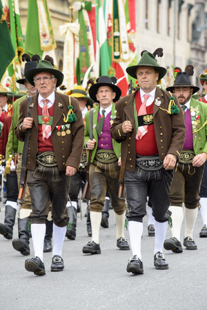 parades: Munich, Germany -  September 20, 2015: The Oktoberfest is the world biggest beer festival and at the opening parade with rd. 9000 participants take part in historical costumes, music bands and horses.
