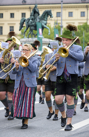 beer festival: Munich, Germany -  September 20, 2015:  The Oktoberfest in Munich, Germany, is the biggest beer festival of th world. About 9000 people in historical costume groups, music bands, artists or riders with horses and carriages have participated at the public