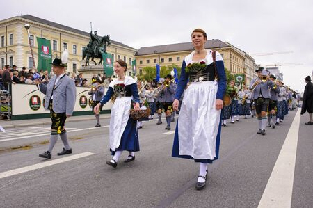 beer festival: Munich, Germany -  September 20, 2015:  The Oktoberfest is the world biggest beer festival and at the opening parade with rd. 9000 participants take part in historical costumes, music bands and horses.