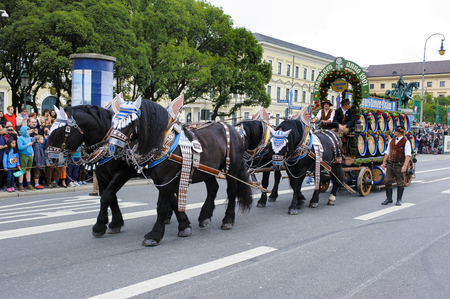 coachman: Munich, Germany -  September 20, 2015: The Oktoberfest in Munich, Germany, is the biggest beer festival of th world. About 9000 people in historical costume groups, music bands, artists or riders with horses and carriages have participated at the public o Editorial
