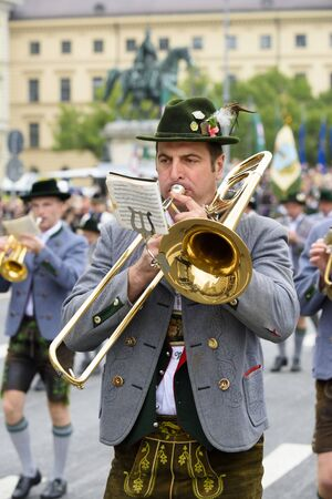 brass band: Munich, Germany -  September 20, 2015: The Oktoberfest in Munich, Germany, is the biggest beer festival of th world. About 9000 people in historical costume groups, music bands, artists or riders with horses and carriages have participated at the public o Editorial